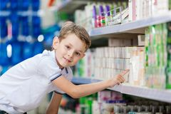 Little boy chooses cosmetics in the store Royalty Free Stock Photos