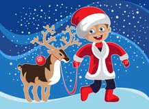 Little boy in Christmas costume with a deer Royalty Free Stock Photography