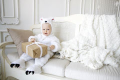 Little boy in Christmas costumes white bears Stock Photos