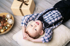 Little boy in Christmas decorations expect a miracle Stock Photos