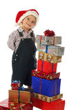 Little boy with Christmas gifts Stock Photography