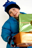 Little boy with christmas gifts Royalty Free Stock Photography