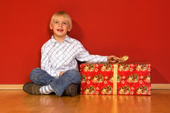 Little boy with christmas gifts Royalty Free Stock Photos
