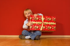 Little boy with christmas gifts Stock Image