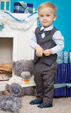 Little boy with Christmas gifts Royalty Free Stock Images
