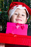 Little boy with Christmas gifts Royalty Free Stock Photo