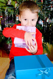 Little boy with Christmas gifts Stock Photos