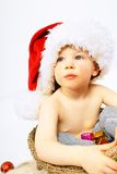 Little boy and christmas hat Stock Photos