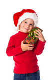 Little boy in christmas hat with gift box Royalty Free Stock Photos