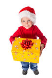 Little boy in christmas hat with gift box Stock Image