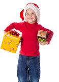 Little boy in christmas hat with gift boxes Royalty Free Stock Image