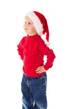 Little boy in Christmas hat Stock Images