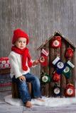 Little boy on christmas, opening presents. Having fun Stock Photography