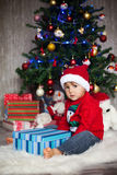 Little boy on christmas, opening presents Stock Images