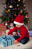 Little boy on christmas, opening presents Stock Photography