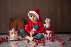 Little boy on christmas, opening presents. Having fun Royalty Free Stock Images