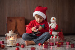 Little boy on christmas, opening presents Stock Photo