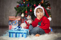 Little boy on christmas, opening presents Stock Image