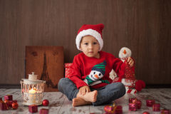 Little boy on christmas, opening presents. Having fun Royalty Free Stock Photo