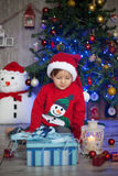 Little boy on christmas, opening presents Stock Photos