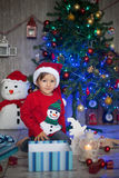 Little boy on christmas, opening presents. Having fun Stock Images