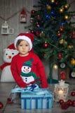 Little boy on christmas, opening presents. Having fun Royalty Free Stock Photos