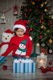 Little boy on christmas, opening presents. Having fun Royalty Free Stock Photography