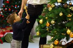 Little boy with christmas ornaments Stock Images