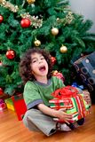 Little boy with a Christmas present Stock Images