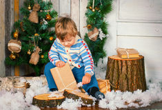Little boy with christmas present Royalty Free Stock Photo