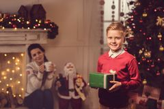 Little boy with christmas present Royalty Free Stock Photography