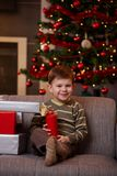 Little boy with christmas presents Stock Photography