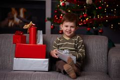 Little boy with christmas presents Royalty Free Stock Photo