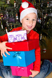 Little boy with Christmas presents Stock Photos