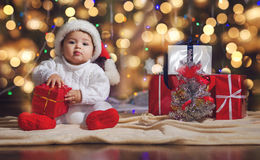Little boy in Christmas Santa's hat Stock Images