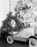 Little boy at Christmas  sitting in his toy car Stock Photos