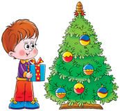 Little boy and Christmas tree Stock Photos