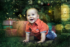 Little boy at the Christmas tree Royalty Free Stock Images