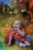 Little boy at the Christmas tree Stock Photos