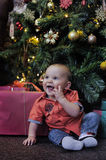 Little boy at the Christmas tree Stock Image