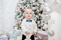 Little boy and Christmas tree. New Year`s and Christmas Stock Photos