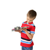 Little boy with cirquit board Stock Photos