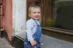 The little boy in the city at the big building Royalty Free Stock Photo