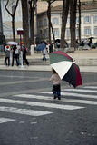 A little boy in city with umbrella Stock Image