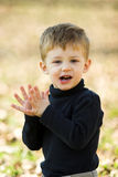A little boy clapping Stock Photos