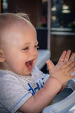 Little boy clapping hands Stock Images