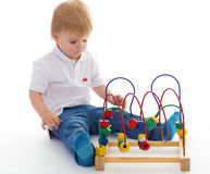 Little boy in the classroom at Montessori environment. Royalty Free Stock Photo