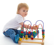 Little boy in the classroom at Montessori environment. Stock Photos