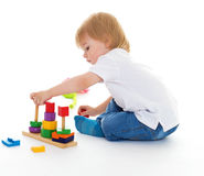 Little boy in the classroom at Montessori environment. Stock Photo