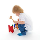 Little boy in the classroom at Montessori environment. Royalty Free Stock Image